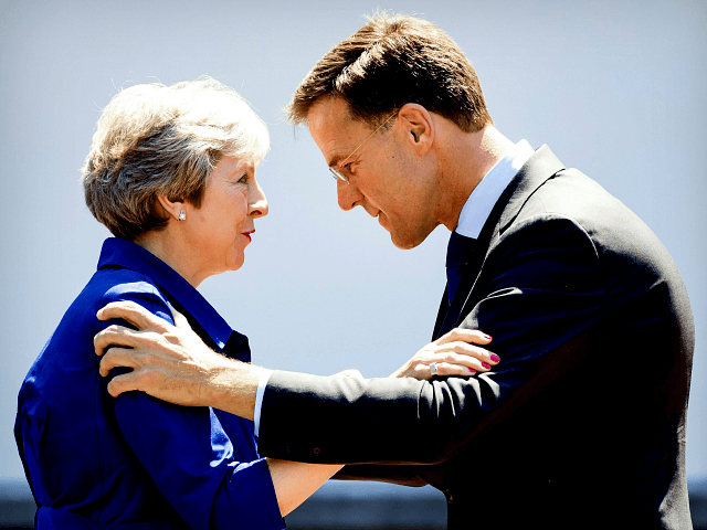 Dutch Prime Minister Mark Rutte receives his British counterpart Theresa May for a work lunch at the Catshuis, The Hague, on July 3, 2018. - The two heads of government will discuss the political and economic relations between the two countries and about the Brexit. (Photo by Koen van Weel …