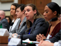 Army Staff Sgt. Patricia King, second from right, together with other transgender military members, from left, Navy Lt. Cmdr. Blake Dremann, Army Capt. Alivia Stehlik, Army Capt. Jennifer Peace and Navy Petty Officer Third Class Akira Wyatt, testify about their military service before a House Armed Services Subcommittee on Military …