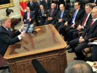 WASHINGTON, DC - FEBRUARY 22: U.S. President Donald Trump (L) speaks during a meeting with Chinese Vice Premier Liu He (R) as other U.S. officials look on in the Oval Office of the White House February 22, 2019 in Washington, DC. Liu is in Washington with the Chinese delegation to participate …