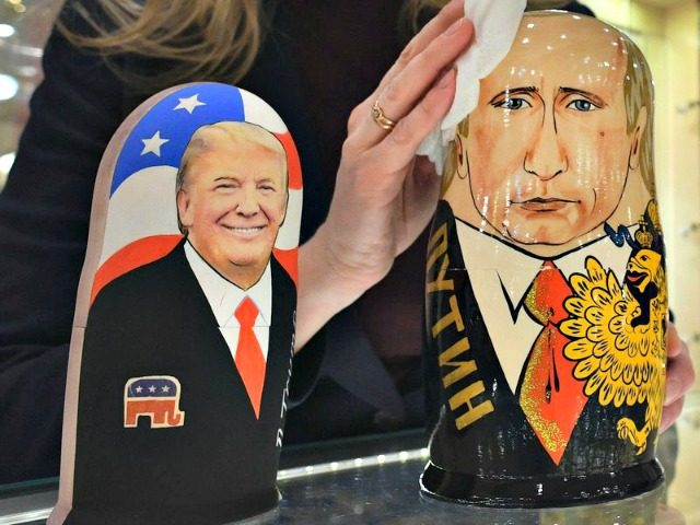 An employee at a Moscow gift shop polishes traditional Russian wooden nesting dolls depicting Donald Trump and Russian President Vladimir Putin. Alexander Nemenov/AFP/Getty Images