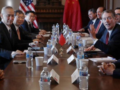 (R-L) Commerce Secretary Wilbur Ross, U.S. Trade Representative Robert Lighthizer, Treasury Secretary Steven Mnuchin and other Trump Administration officials sit down with Chinese Vice Premier Liu He (L), Central Bank Governor Yi Gang (2nd L) and other Chinese vice ministers and senior officials for negotiations in the Diplomatic Room at …