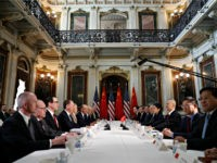 U.S. and Chinese delegations meet in the Indian Treaty Room in the Eisenhower Executive Office Building on the White House complex, during continuing meetings on the U.S.-China bilateral trade relationship, Thursday, Feb. 21, 2019, in Washington. Chinese Vice Premier Liu He, third from right, sits across the table from the …