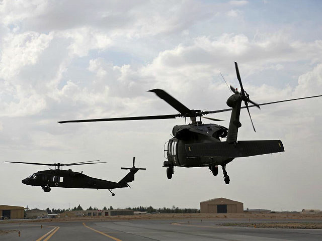 In this Monday, March 19, 2018 photo, UH-60 Black Hawk helicopters carrying U.S. and Afghan trainees take off at Kandahar Air Field, Afghanistan. The U.S. military has been flying UH-60 Black Hawk helicopter missions in Afghanistan for years, but the storied aircraft will soon take to the country's battlefields manned …