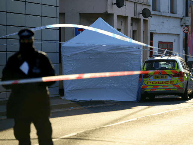 LONDON, ENGLAND - APRIL 05: A forensic tent covers the scene where a man, aged 20, collapsed after being fatally stabbed last night near Link Street, Hackney, on April 5, 2018 in London, England. The man approached police officers and was given first aid at the scene but later died. …