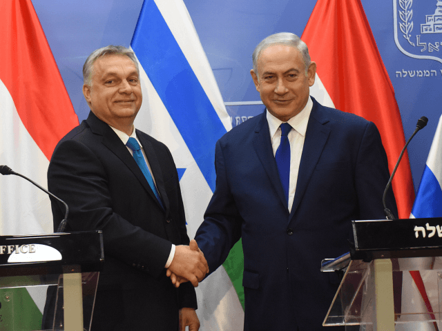 Hungarian Prime Minister Viktor Orban (L) and Israeli Prime Minister Benjamin Netanyahu (R) shake hands after making joint statements at the prime minister's office in Jerusalem, Israel, July 19, 2018. - Hungarian Prime Minister Viktor Orban advocated 'zero tolerance' against anti-Semitism, at the start of his controversial visit to Israel.Orban …