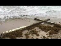 FORT LAUDERDALE, FLA. (WSVN) - A giant cross washed ashore near a Fort Lauderdale Beach hotel over the weekend, spawning curiosity among beachgoers and employees as to how it arrived in South Florida.