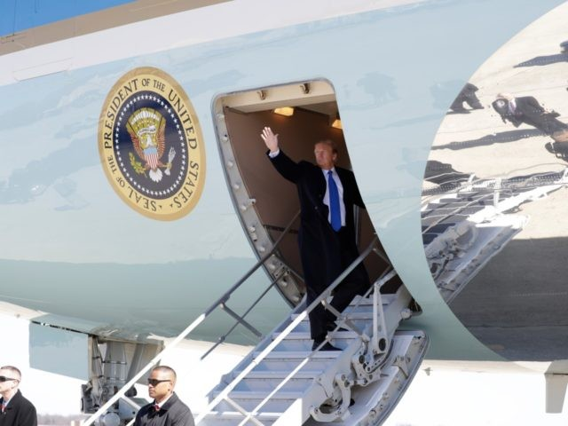 President Donald Trump waves while boarding Air Force One for a trip to Vietnam to meet with North Korean leader Kim Jong Un, Monday, Feb. 25, 2019, in Andrews Air Force Base, Md. (AP Photo/ Evan Vucci)