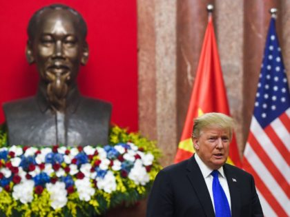 TOPSHOT - US President Donald Trump stands next to a bust of late president Ho Chi Minh as he arrives for a meeting with Vietnamese President Nguyen Phu Trong at the Presidential Palace in Hanoi on February 27, 2019, ahead of the second US-North Korea summit. (Photo by Saul LOEB …