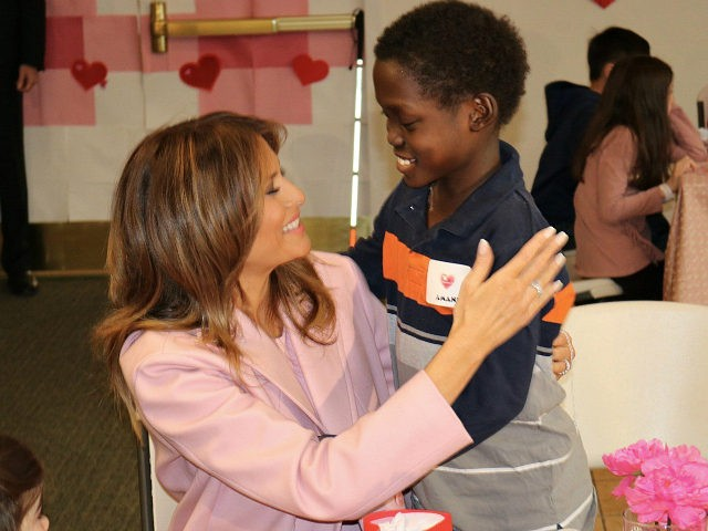 First Lady Melania Trump embraces Amani after he presented her with a Valentine gift (Michelle Moons/Breitbart News)