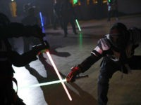 "In this Sunday, Feb. 10, 2019, photo, competitors battle during a national lightsaber tournament in Beaumont-sur-Oise, north of Paris. ""We wanted it to be safe, we wanted it to be umpired and, most of all, we wanted it to produce something visual that looks like the movies, because that is …"