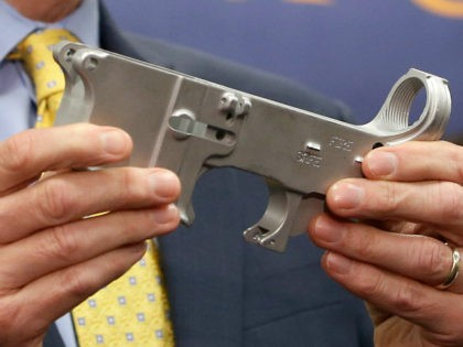 Benjamin Wagner, the United States Attorney for the Eastern District of California, displays a firearm part that can be used to make a untraceable assault-style weapon, during a news conference in Sacramento, Calif., Thursday, Oct. 15, 2015. Wagner announced that a federal grand jury indicted 8 men on a variety …