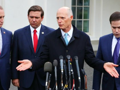WASHINGTON, DC - JANUARY 22: Sen. Rick Scott (R-FL) speaks to the media while flanked by (L-R) Rep. Mario Diaz-Balart (R-FL), Florida Governor Ron DeSantis and Sen. Marco Rubio (R-FL), after a meeting with President Donald Trump regarding Venezuela on January 22, 2019 in Washington, DC. (Photo by Mark Wilson/Getty …
