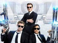 Liam Neeson, Chris Hemsworth, and Tessa Thompson in Men in Black: International (2019)