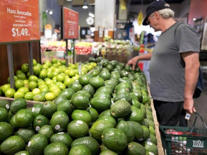 A man shops for avocados at a Whole Foods Market, Monday, Aug. 28, 2017, in New York. Amazon is moving swiftly to make big changes at Whole Foods, saying it plans to cut prices on avocados, bananas, eggs, salmon, beef and more. Amazon has completed its $13.7 billion takeover of …
