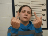 A New Jersey woman suspected of breaking into cars showed cops how she really felt about her arrest — by flipping the bird with both hands in her mugshot.
