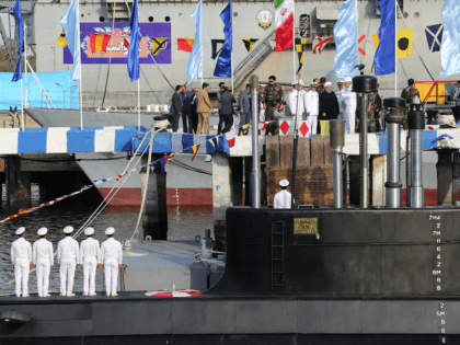 """In this photo released by official website of the office of the Iranian Presidency, President Hassan Rouhani, center with white turban, and other dignitaries attend the inauguration of Fateh, """"Conqueror"""" in Persian, Iranian made semi-heavy submarine in the southern port of Bandar Abbas, Iran, Sunday, Feb. 17, 2019. The Fateh …"""