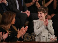 WASHINGTON, DC - FEBRUARY 05: First lady Melania Trump with Grace Eline, special guest of President Donald Trump, looks during of the State of the Union address in the chamber of the U.S. House of Representatives on February 5, 2019 in Washington, DC. President Trump's second State of the Union …