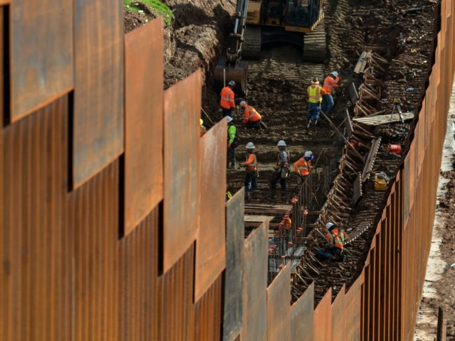 TOPSHOT - Workers reinforce a section of the US-Mexico border fence, as seen from eastern Tijuana, in Baja California state, Mexico, on January 18, 2019. - A new caravan of Central American migrants trying to reach the United States made its way across Guatemala Thursday, with the first members crossing …