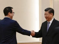 US Treasury Secretary Steven Mnuchin shakes hands with Chinese President Xi Jinping (2nd R) as US Trade Representative Robert Lighthizer (L) and Chinese Vice Premier Liu He (R) look on before proceeding to their meeting at the Great Hall of the People in Beijing on February 15, 2019. (Photo by …