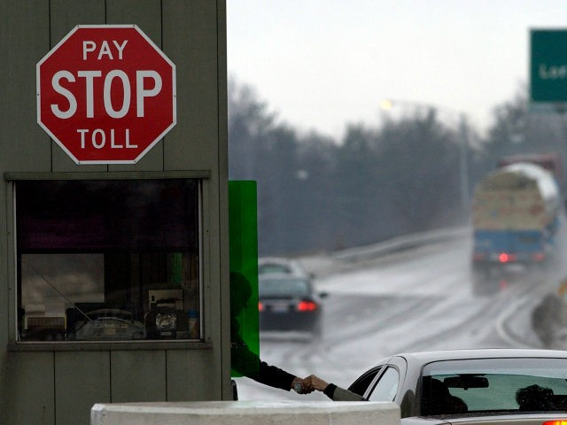 A turnpike worker collects a toll at a toll booth off the Ohio Turnpike Tuesday, Jan. 11, 2005 in North Ridgeville, Ohio. Ohio turnpike workers are negotiating a contract following a weeklong strike by Pennsylvania turnpike workers that failed to disrupt toll collections. (AP Photo/Tony Dejak)