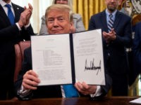 US President Donald Trump shows his signature on the Space Policy Directive-4 (SPD-4) on February 19, 2019, at the White House in Washington, DC. - Trump, on June 18, 2018, directed the US Defense Department to establish a Space Force as the sixth branch of the Armed Forces. SPD-4 outlines …