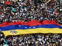 Rival rallies begin in tense Venezuela as air force general defects
