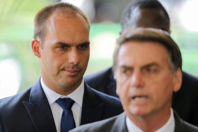 President-elect Jair Bolsonaro (R) pictured with his son Eduardo Bolsonaro (L), who is said to have joined a nationalist group founded by Steve Bannon, the former White House strategist