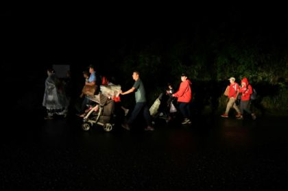 Honduran migrants part of a caravan to the United States leave San Pedro Sula, Honduras on January 14, 2019
