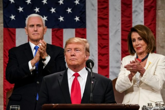 US President Donald Trump delivers the State of the Union address in the US Capitol, with Vice President Mike Pence and Speaker of the House Nancy Pelosi behind him