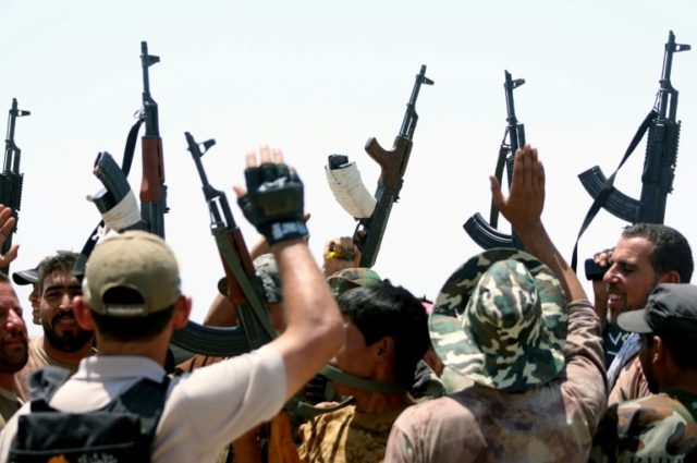 By law or force: Iraq's Shiite armed groups vow to oust US troops
