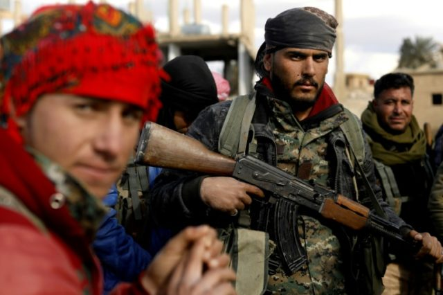 Fighters with the US-backed Syrian Democratic Forces (SDF) in the front line Syrian village of Baghouz on February 18, 2018