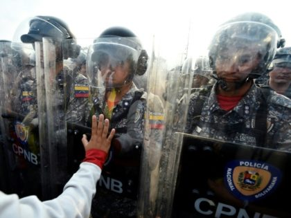 Venezuelans confronted police and demanded that humanitarian aid sent to Colombia be allowed in the country
