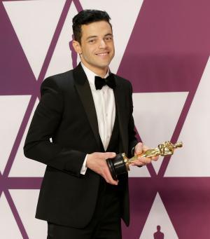 Rami Malek falls off stage at Oscars, treated by paramedics