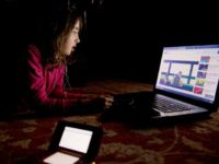 young girl watching YouTube videos