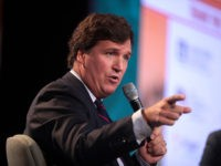 Tucker Carlson speaking with attendees at the 2018 Student Action Summit hosted by Turning Point USA at the Palm Beach County Convention Center in West Palm Beach, Florida.