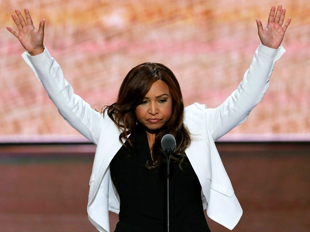Lynne Patton of the Eric Trump Foundation waves during her speech during the third day of the Republican National Convention in Cleveland, Wednesday, July 20, 2016. (AP Photo/J. Scott Applewhite)