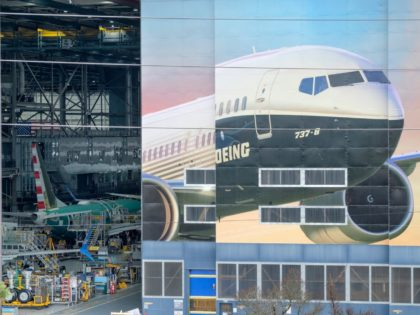 The Boeing 737-8 is pictured on a mural on the side of the Boeing Renton Factory on March 11, 2019 in Renton, Washington. Two of the aerospace company's newest model airliners have crashed in less than six months. (Photo by Stephen Brashear/Getty Images)