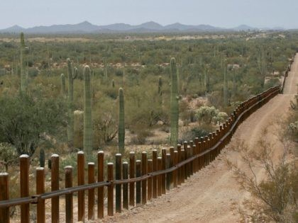 Cartel-connected human smugglers continue to exploit outdated vehicle-barrier technology to smuggler thousands of Central American migrants into the Arizona desert. (AP File Photo/Matt York)
