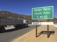 In this Thursday, Dec. 14, 2017 photo, a sign warns of the upcoming California Pine Valley checkpoint, on the main route from Arizona to San Diego. California legalizes marijuana for recreational use Jan. 1 but that won't stop federal agents from seizing small amounts on busy freeways and backcountry highways. …