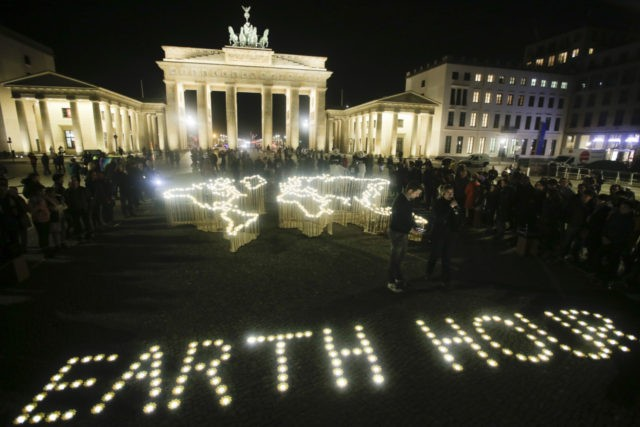 Activists of the World Wide Fund For Nature (WWF) set up led-lights in front of the illuminated Brandenburg Gate to mark Earth Hour, in Berlin, Saturday, March 30, 2019. The global event Earth Hour is the symbolic switching off of the lights for one hour to help minimalize fossil fuel …