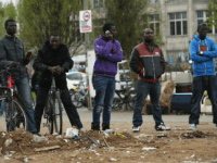BERLIN, GERMANY - APRIL 08: Refugees from Africa watch as other tear down their huts at a temporary, city-tolerated refugee camp at Oranienplatz in Kreuzberg district on April 8, 2014 in Berlin, Germany. Refugees, many of them from Africa who came to Germany via Lampedusa, began dismantling their shelters today …