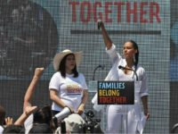 FILE - In this June 30, 2018 file photo, America Ferrera, left, with Alicia Keys, attends a protest against the Trump administration's approach to illegal border crossings and separation of children from immigrant parents in Lafayette Square across from the White House in Washington. After paying a weekend visit to …