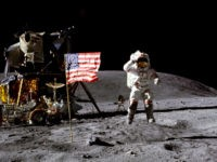 In this April 1972 photo made available by NASA, John Young salutes the U.S. flag at the Descartes landing site on the moon during the first Apollo 16 extravehicular activity. NASA says the astronaut, who walked on the moon and later commanded the first space shuttle flight, died on Friday, …