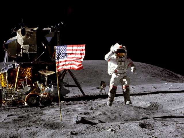 NASA John Young salutes the U.S. flag at the Descartes landing site on the moon during the first Apollo 16 extravehicular activity. NASA says the astronaut who walked on the moon and later commanded the first