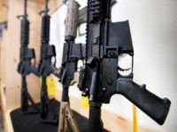 AR-15 semi-automatic guns are on display for sale at Action Target on June 17, 2016 in Springville, Utah.