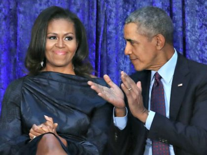 WASHINGTON, DC - FEBRUARY 12: Former U.S. President Barack Obama and first lady Michelle Obama participate in the unveiling of their official portraits during a ceremony at the Smithsonian's National Portrait Gallery, on February 12, 2018 in Washington, DC. The portraits were commissioned by the Gallery, for Kehinde Wiley to …