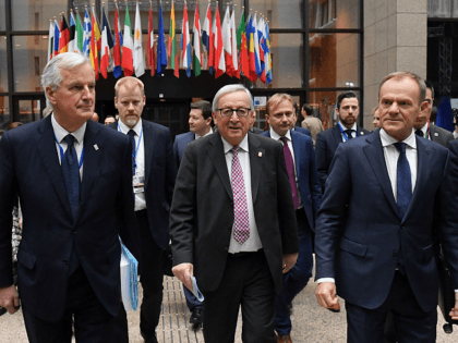 EU chief Brexit negotiator Michel Barnier (L), President of the European Commission Jean-Claude Juncker (C) and European Council President Donald Tusk on their way to a press conference following a special meeting of the European Council to endorse the draft Brexit withdrawal agreement and to approve the draft political declaration …