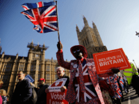 TOPSHOT - Pro-Brexit activists march outside the Houses of Parliament in central London on February 27, 2019. - Prime Minister Theresa May will today face a vote by MPs over her newly revised Brexit strategy, which allows for a possible request to delay Britain's EU departure if her divorce deal …