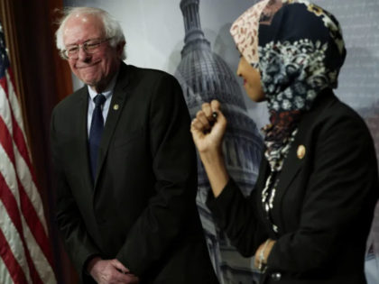 U.S. Rep. Ilhan Omar (D-MN) (R) and Sen. Bernie Sanders (I-VT) (L) share a moment during a news conference on prescription drugs January 10, 2019 at the Capitol in Washington, DC. Congressional Democrats held a news conference to introduce a legislative package 'that would drastically reduce prescription drug prices in …