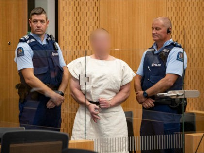 (EDITOR'S NOTE: Parts of this image have been pixelated at source to conceal the identity of the defendant due to court order.) The man charged in relation to the Christchurch massacre, Brenton Tarrant, gestures in the dock for his appearance for murder in the Christchurch District Court on March 16, …